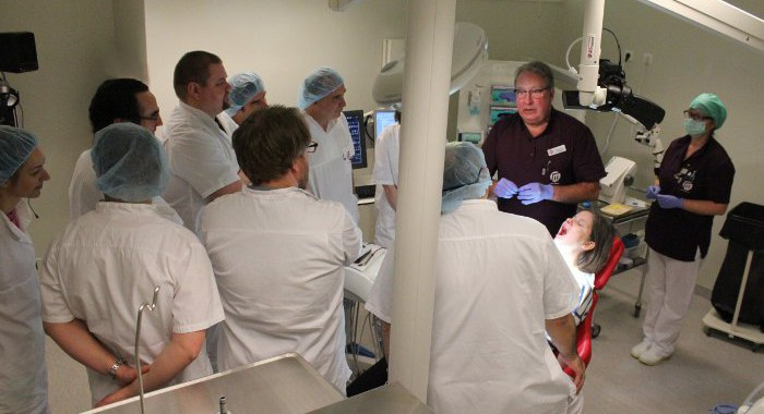 Dental implant certification students